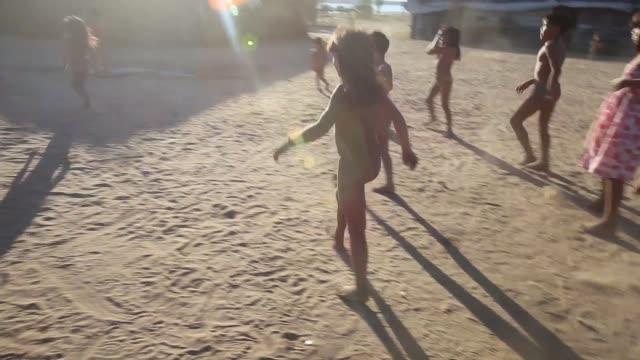 ts children of the kamayura tribe play football shot on june 14th 2014 - 先住民文化点の映像素材/bロール