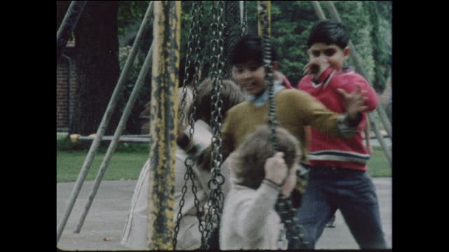 children on a school field trip and enjoying the swings park in the united kingdom circa 1968 no sound - swinging stock videos & royalty-free footage