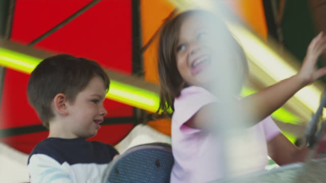 MS PAN Children (2-5) on amusement park ride / Rutland, Vermont, USA