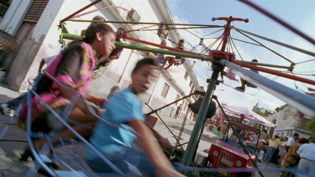 CU, CS, Children on amusement park ride, Santiago de Cuba, Cuba
