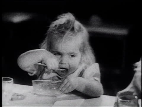 1945 montage children on carousel ride and eating food / united states - frank capra video stock e b–roll