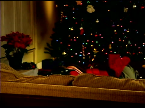 children on couch wearing reindeer antlers at christmas - see other clips from this shoot 1407 stock videos and b-roll footage