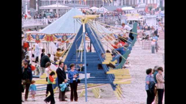 children on fairground rides at weymouth beach, uk; 1975 - roundabout stock videos & royalty-free footage