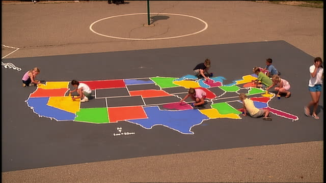 ha ws children on playground filling in states with different colors on outline map of us/ michigan - us state border stock videos & royalty-free footage