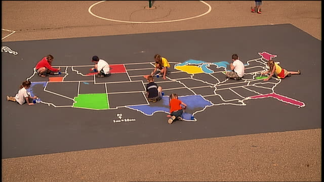 HA WS children on playground filling states in with different colors on outline map of US/ Michigan