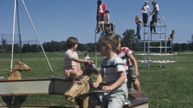 1956 ws children on playground / usa - jungle gym stock videos and b-roll footage