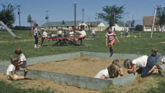 1956 ws children on playground / usa - school yard stock videos and b-roll footage