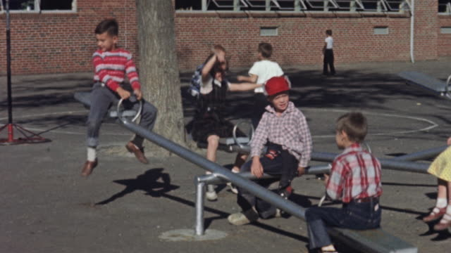 1956 WS Children on seesaw on playground / USA
