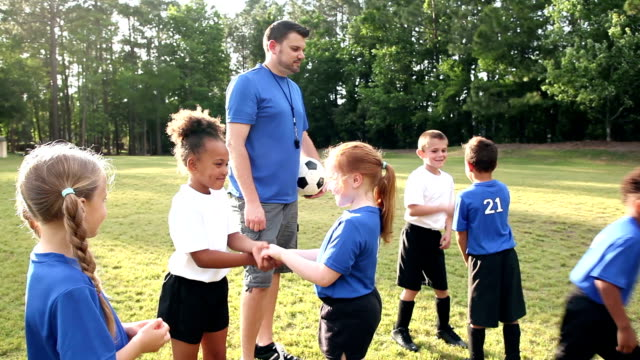 children on soccer team shaking hands with opponents - greeting stock videos & royalty-free footage