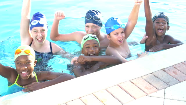 children on swim team in pool, raise arms and cheer - competitive sport stock videos & royalty-free footage