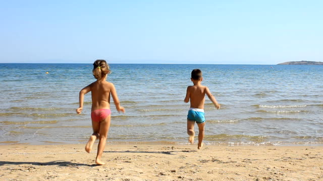 children on the beach - water's edge stock videos & royalty-free footage