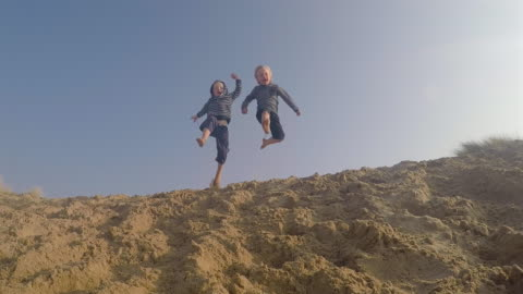 children on the beach - brother stock videos & royalty-free footage