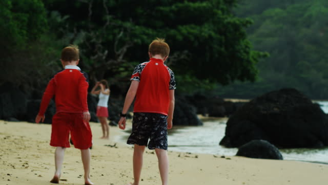 children on the beach - swimming shorts stock videos & royalty-free footage