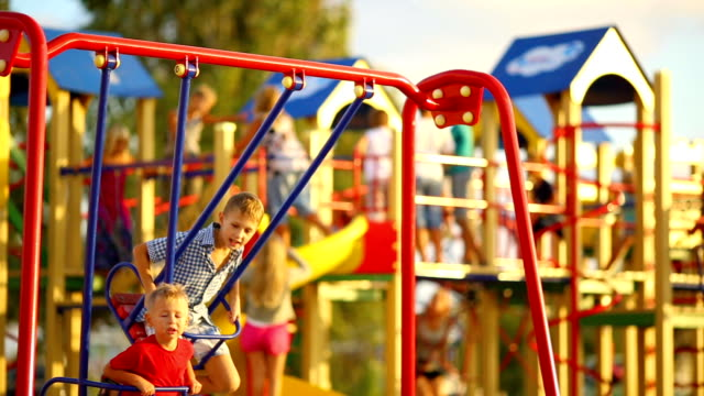 children on the swings at the playground - playground stock videos & royalty-free footage