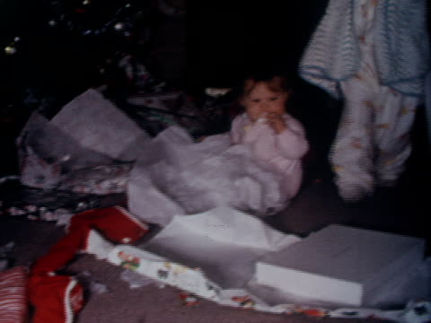 children open gifts on christmas morning. - 1962 stock-videos und b-roll-filmmaterial