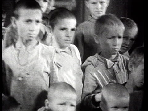 Children orphaned after World War II receiving clothes and surviving among city ruins/ Volgograd Russia/ AUDIO