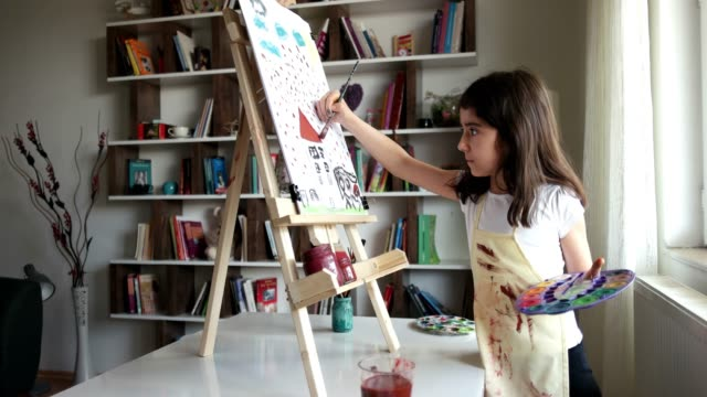 children painting finger on easel. - human face drawing stock videos & royalty-free footage