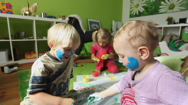 MS Children (12-23 months, 2-5 years) painting on themselves / Potsdam, Brandenburg, Germany