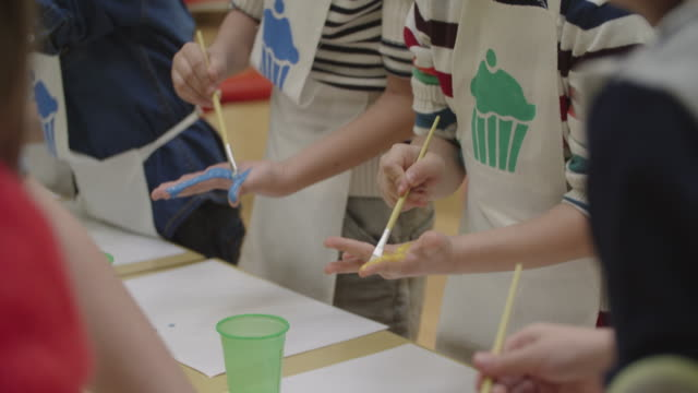 4k: children painting their hands with watercolors - unrecognisable person stock videos & royalty-free footage