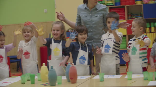 4k: children painting their hands with watercolors - preschool stock videos and b-roll footage