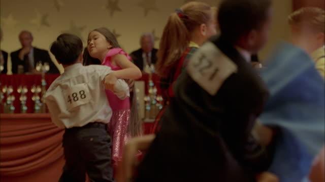Children participate in a swing dance competition.