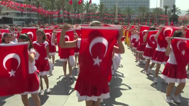 children perform at cumhuriyet square as part of the national sovereignty and children's day celebrations marking the 98th anniversary of foundation... - time of day stock videos and b-roll footage