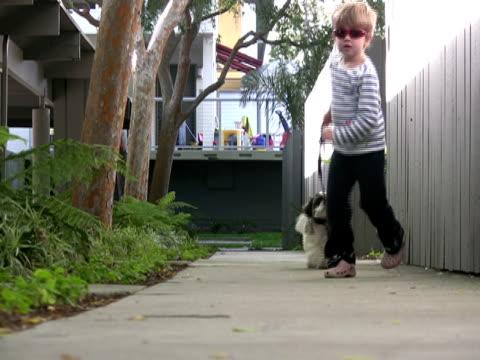 Children & Pets; Running Dog Past Camera