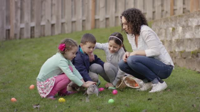 Children petting a bunny