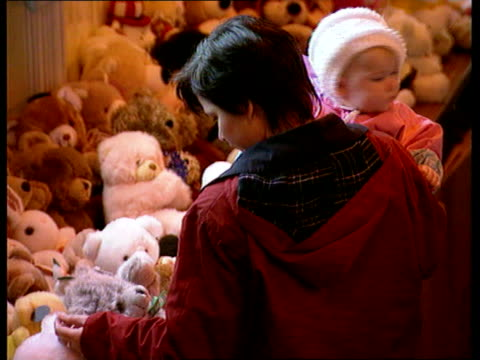 Children pick out teddy bears SCOTLAND Perthshire Dunblane TGV Hall filled with teddy bears sent after Dunblane massacre as people viewing PAN RL MS...