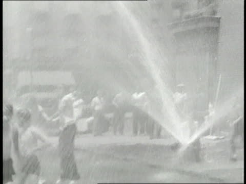 children play in the spray of a fire hydrant during a heatwave - fire hydrant stock videos & royalty-free footage