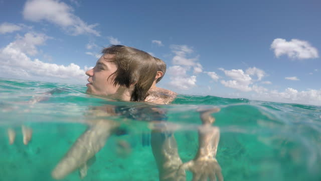 children play in the water - huahine island stock videos and b-roll footage