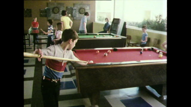 children play indoors at uk holiday resort; 1981 - 1981 stock videos & royalty-free footage