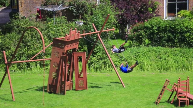 """vidéos et rushes de children play on a swing seen from on top of the steel replica of the """"uniastate"""" designed by artist bep mulder on july 12, 2020 in bears, the... - balançoire"""