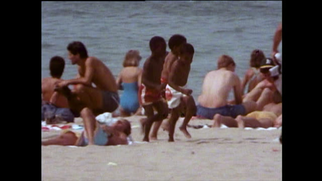 children play on crowded beach on lake michigan; 1989 - semi dress stock videos & royalty-free footage