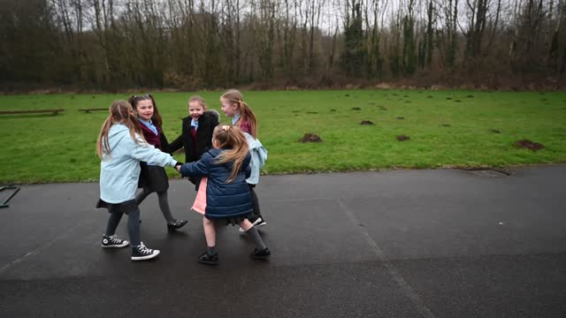 children play outdoors at glan-yr-afon primary school on march 3, 2021 in cardiff, wales. children aged three to seven began a phased return to... - child stock videos & royalty-free footage