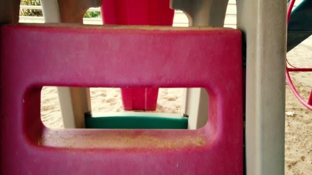 vídeos de stock e filmes b-roll de children play slides in the children's playground. human eye view - equipamento de parque infantil