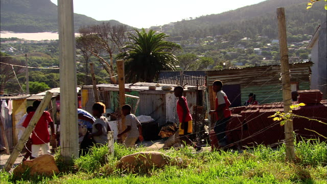 children play soccer in a shanty town near cape town, south africa. - africa stock videos & royalty-free footage