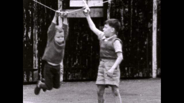 children play together outdoors in residential london; 1969 - biografi bildbanksvideor och videomaterial från bakom kulisserna