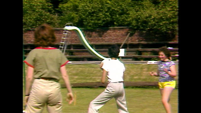 children play volleyball together outdoors; 1984 - netting stock videos & royalty-free footage