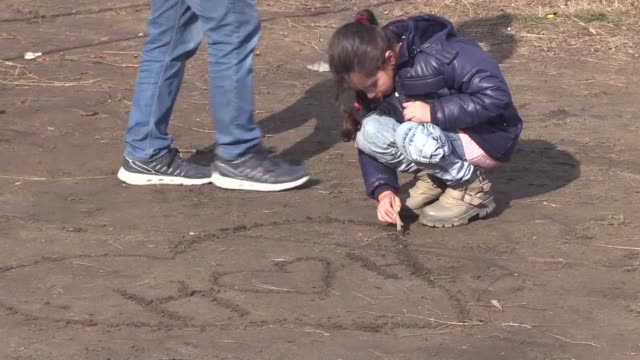 children play where irregular migrants wait at turkey's border with greece in northwestern edirne province of turkey on february 29, 2020. thousands... - istanbul province stock videos & royalty-free footage