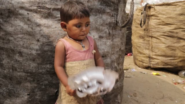 children play where their mother works in a plastic bottle recycling factory in dhaka, bangladesh, on february 08, 2018. after removing the labels... - other stock videos & royalty-free footage