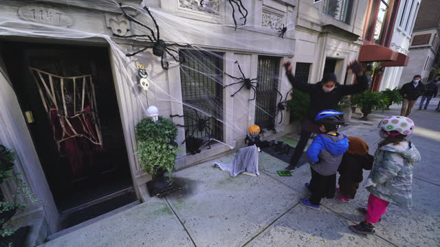 children play with a big spider on october 31 in new york city. - baby boys stock videos & royalty-free footage