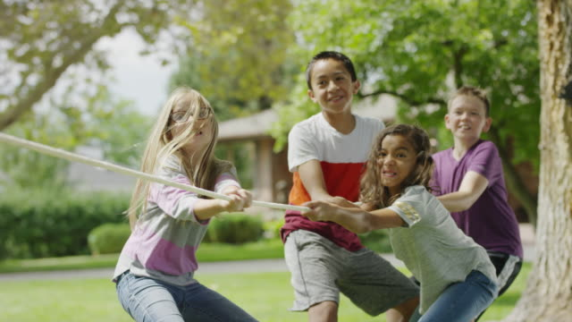 children playing and celebrating winning tug-of-war / provo, utah, united states - provo stock videos & royalty-free footage