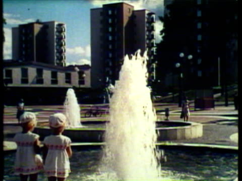 1953 ws children playing around fountain / stockholm, sweden / audio - 1950 stock videos & royalty-free footage