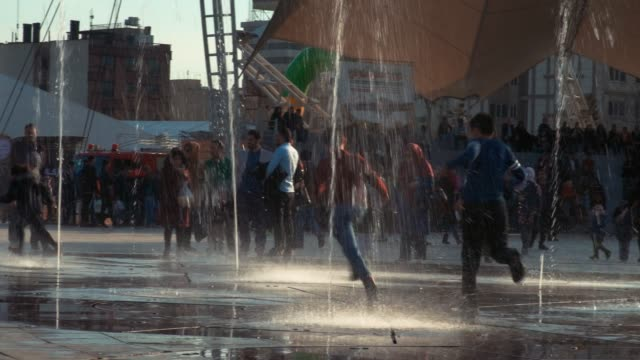 children playing around the fountains public park - tehran stock videos & royalty-free footage
