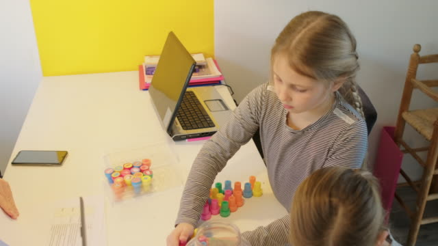 children playing at desk - 45 49 anni video stock e b–roll