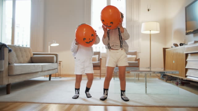 children playing at home during halloween - decoration stock videos & royalty-free footage