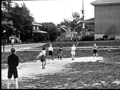 B/W PAN Children playing baseball , Ottawa, Canada / AUDIO