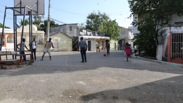 santa domingo dominican republic november 29 2012 children playing basketball on the street in the poor neighbourhood 'los alcarrizos' in santa... - hispaniola stock videos and b-roll footage