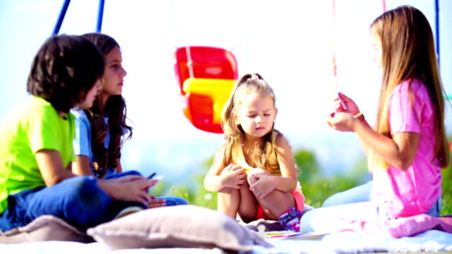 children playing board game outdoors. - blanket background stock videos & royalty-free footage